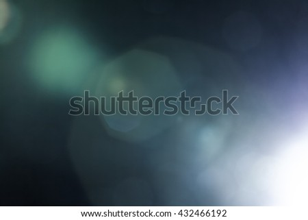 Photo of  Real Lens Flare Shot in Studio over Black Background. Easy to add as Overlay or Screen Filter over Photos