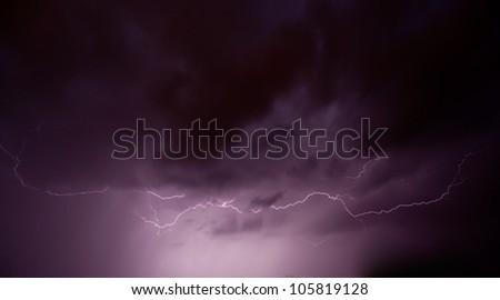 Real lightning on stormy sky