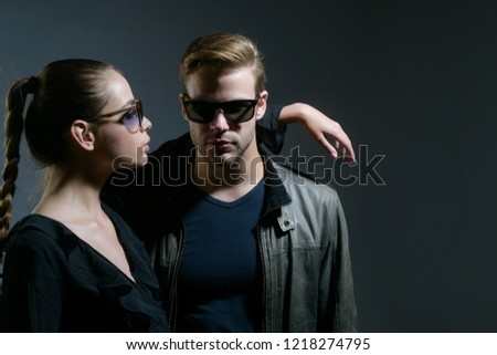 Real love. Fashion models in trendy sun glasses. Couple in love. Couple of man and woman wear fashion glasses. Love relations. Friendship day. Friendship relations. Feeling flirty. #1218274795