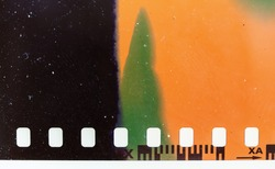 real macro photo of exposed 35mm film material with light leaks or sunstrokes, negative film strip template, color 135 type.