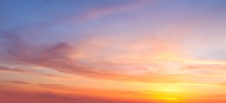Real majestic sunrise sundown sky background with gentle colorful clouds without birds. Panoramic, big size