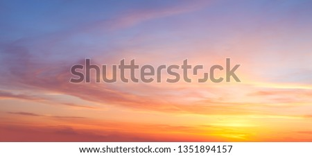 Real majestic sunrise sundown sky background with gentle colorful clouds without birds. Panoramic, big size #1351894157