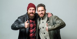 Real men and brotherhood. Friends glad see each other. Friendly relations. Friendship of brutal guys. Real friendship mature friends. Male friendship concept. Brutal bearded men wear leather jackets.