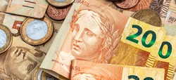Real, Money from Brazil. Dinheiro, Brasil, Reais, Moedas. A group of brazilian banknotes and coins in close-up.