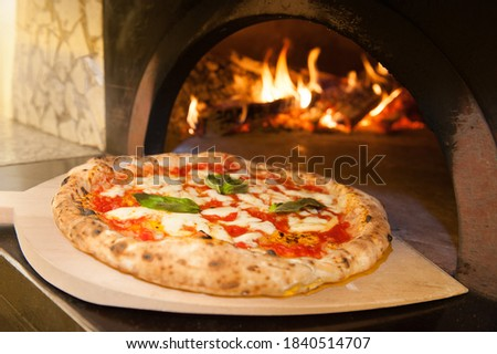 real Neapolitan Italian pizza called margherita pizza just out of the oven