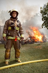Real People - Firefighter Portrait with house on fire in background