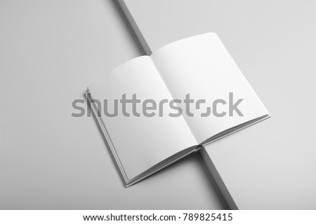 Real photo, blank book, brochure, booklet mockup template, hard cover, isolated on light grey background to place your design.  - Shutterstock ID 789825415