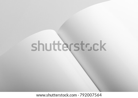Real photo, brochure mockup template, softcover, closeup, isolated on light grey background to place your design. - Shutterstock ID 792007564