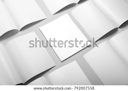 Real photo, brochure mockup template, softcover, collage, stack, isolated on light grey background to place your design. - Shutterstock ID 792007558