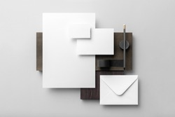 Real photo, stationery branding mockup template, isolated on light grey background with wooden elements to place your design.