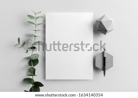 Real photo, stationery branding mockup template to place your design, isolated on light grey background, with concrete, copper, granite and floral elements. Stockfoto ©