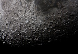 real picture of the moon surface taken by telescope, illustrates how cratered is the south side of it