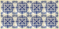 Real portuguese classic wall tiles in blue tones against white. Architecture materials in buildings.