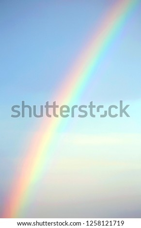 real rainbow after the storm and the blue sky in the background #1258121719
