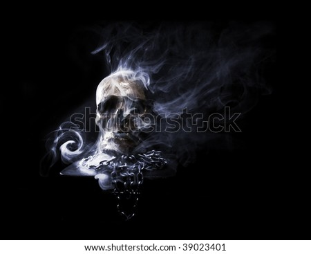 real skull with chain in abstract smoke