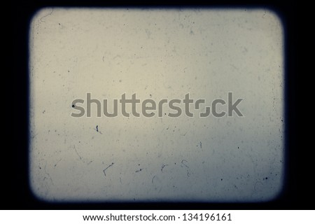 Real slide projector screen with optical effects and dust.