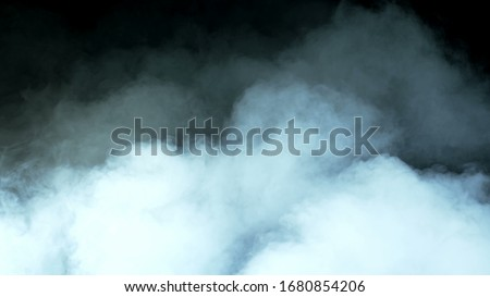 Photo of  Real Smoke on a black background - realistic overlay for different projects.