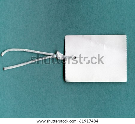 Real Tag With String On Color Paper