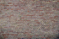 Real vintage Bumpy, rough and old brick texture with imperfect, dilapidate, impair, corroded and defective English brick bond pattern.