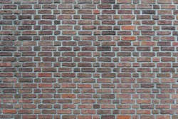 Real vintage Bumpy, rough and old brick texture with imperfect, dilapidate, impair, corroded and defective Flemish bond brick pattern.