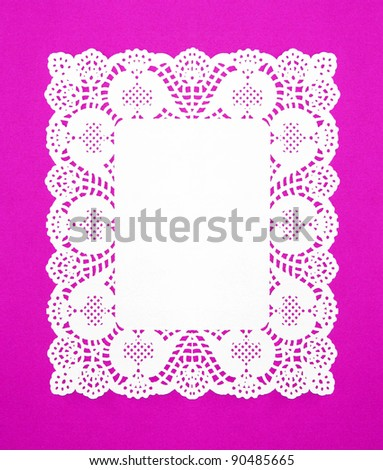 Real White Doily isolated on Fuchsia / Purple background