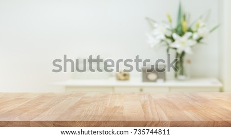Real wood table top texture on white wall room background.For create product display or design key visual layout