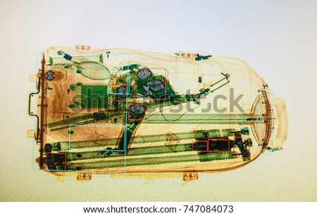 Real X-ray image of the suitcase at the airport security service