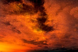 Realistic abstract nature texture of Moody and scary Dark clouds & stars in red & orange night sky space for background, backdrop, template & wallpaper. Mystery Planet, Universe & cosmology concept