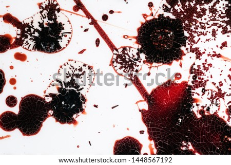 Realistic bloody splatters. Drop and blob of blood. Bloodstains. #1448567192