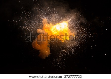 Realistic fiery explosion busting over a black background #372777733