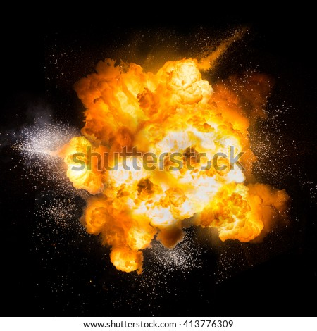 Realistic fiery explosion over a black backgroun #413776309