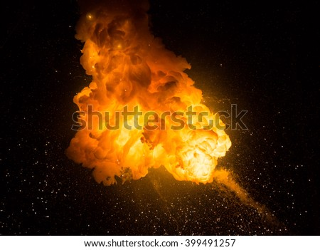 Realistic fiery explosion over a black background #399491257