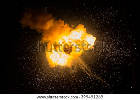 Realistic fiery explosion over a black background #399491269