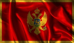 Realistic flag of Montenegro on the wavy surface of fabric. This flag can be used in design.