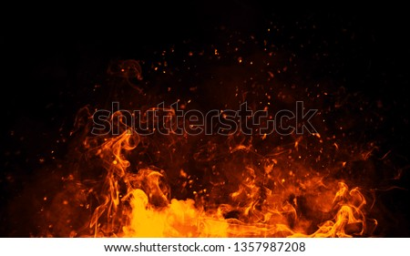 Realistic isolated fire effect for decoration and covering on black background. Concept of particles , sparkles, flame and light. Foto stock ©