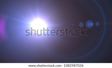 Realistic lens flare light effect , Beautiful rays of light over black background #1082987036