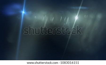 Realistic lens flare light effect , Beautiful rays of light over black background #1083016151