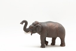 Realistic miniature elephant figure isolated on a white background. Elephant Toy. Copy space