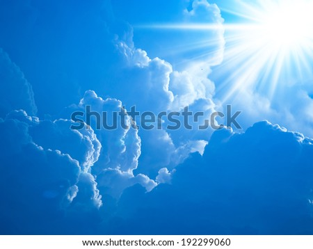 Realistic shining sun with lens flare. Blue sky with clouds back