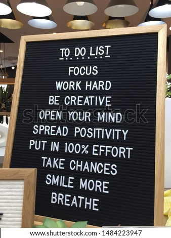 Realistic To Do List white text on black letter board in a shop. Focus. Work Hard. Be Creative. Open Your Mind. Spread Positivity. Take Chances. Smile More. Breathe. Positive Quotes. - Image #1484223947