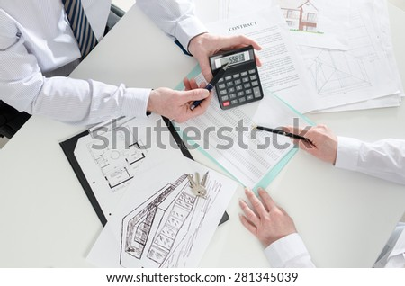 Realtor advising his client in real estate agency