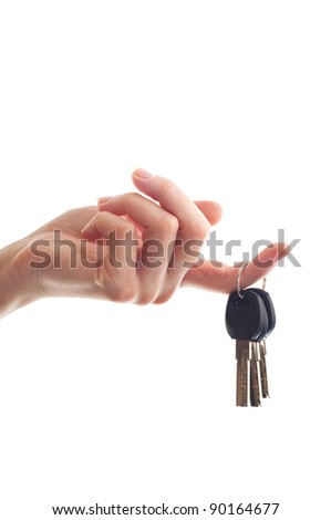 realtor female hand holding door key to new house or flat isolated on white background
