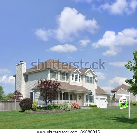 Realtor For Sale Sign on Front Yard Lawn of Beautiful Suburban Residential District Home Sunny Clouds Blue Sky