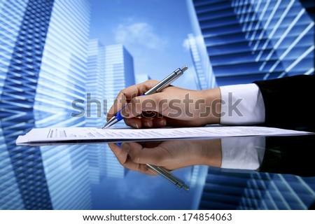Realtor signing contract on skyscrapers background