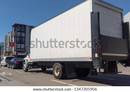 Rear and side view of shipping transportation in traffic. #1347305906