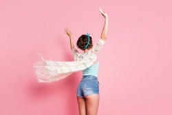 Rear back behind view of her she nice attractive sporty curvy fit thin brown-haired girl rising hands up having fun air wind blowing isolated over pink pastel color background