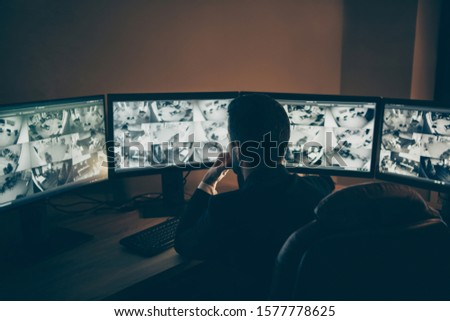 Rear back behind view of his he professional professional man safeguard supervising online remote panel night shift providing company safety late evening at work workplace workstation