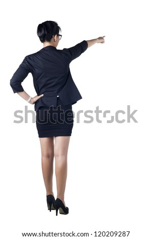 Rear / Back view of business woman standing and pointing. Isolated white background. Model is Asian woman.