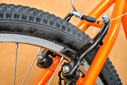 Rear bicycle break with carbon fiber wheel