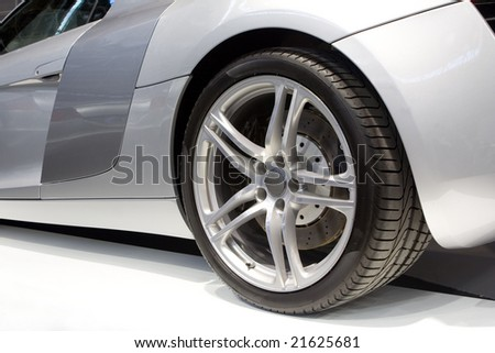 Rear End of a New Sports Car - stock photo